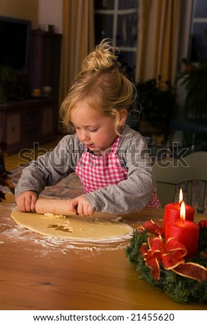 Child bakes Christmas cookies in Advent - stock photo