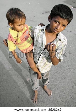child beggar on the street, delhi, india - stock photo