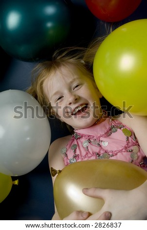 child between balloons - stock photo