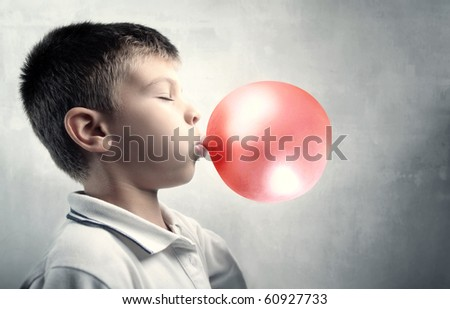 Child blowing a bubble gum - stock photo