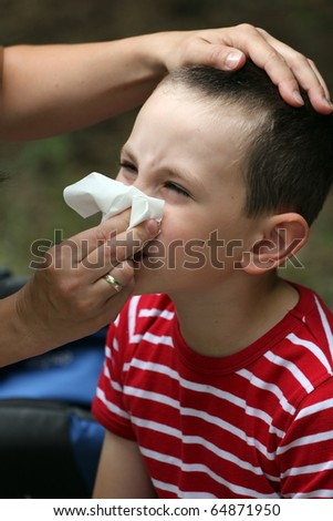 Child blowing nose. Child with tissue. catarrh or allergy - stock photo