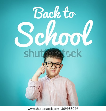 "Child boy and blackboard with ""back to school"" on background, School concept - stock photo"