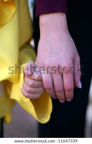 Child Boy and mother hands - help and support - stock photo