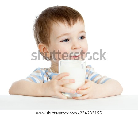 child boy drinking milk or yogurt from glass - stock photo