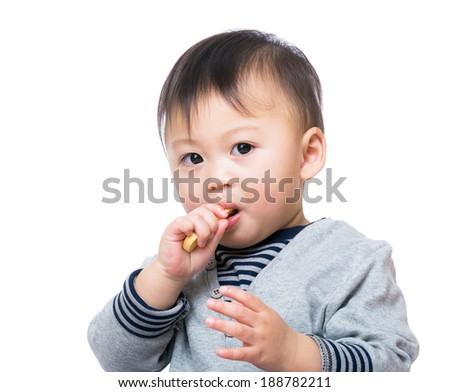 Child boy eating snack - stock photo