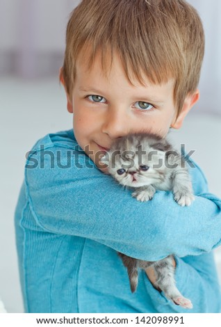 child boy holding cat kitten isolated - stock photo