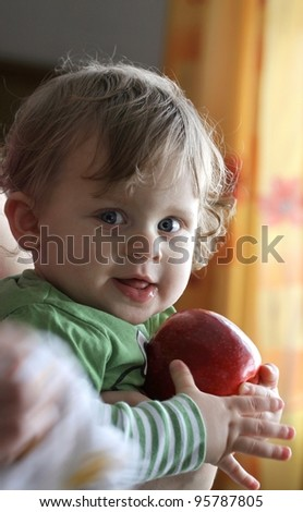 child boy holds an apple - stock photo