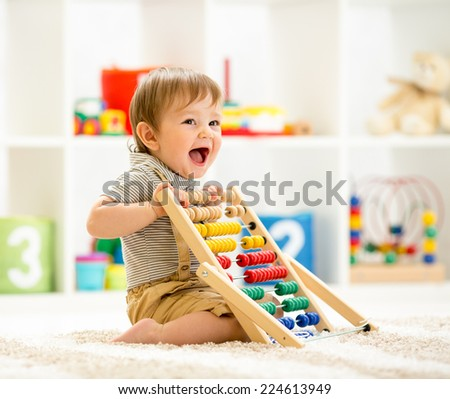 child boy playing with abacus - stock photo