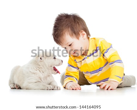child boy playing with puppy dog - stock photo