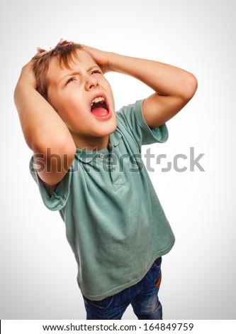 child boy upset angry shout produces evil face portrait isolated emotion - stock photo