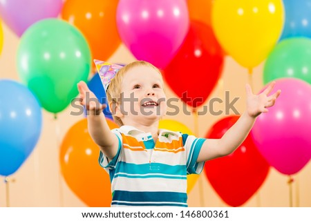 child boy with balloons on birthday party