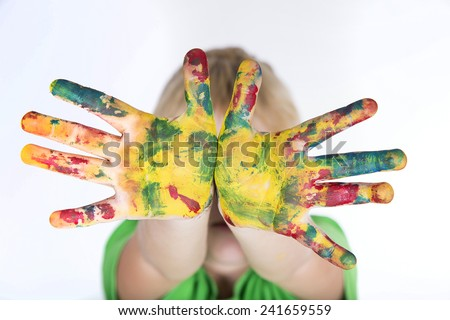 child boy with colorful painted hands - stock photo