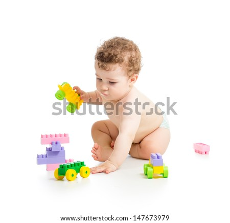 child boy with construction set over white background - stock photo