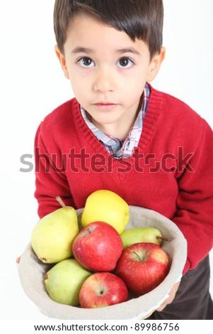 Child bringing basket fruit on white background - stock photo