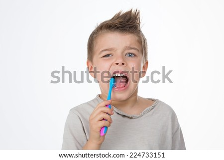 child brushes his molar with caries - stock photo
