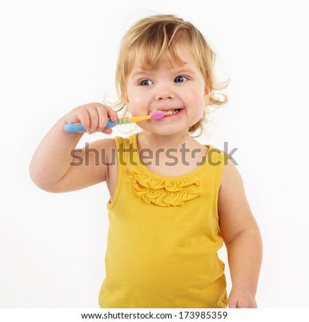 child  brushing teeth isolated on white  - stock photo