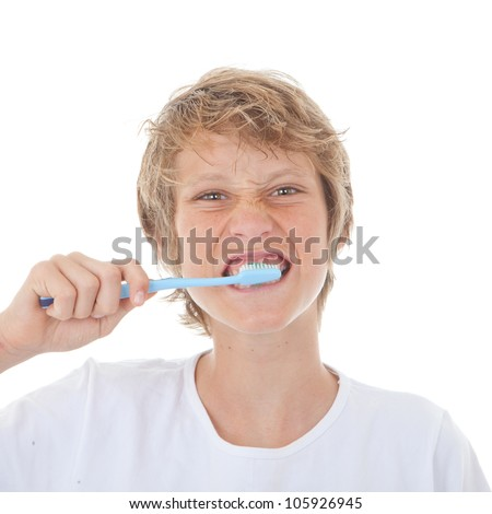 child brushing teeth with toothbrush and toothpaste - stock photo
