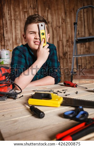 child builder for construction  work concept, funny boy builder shows Tools