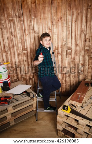 child builder for construction  work concept, funny boy ,It shows screwdriver space for text - stock photo