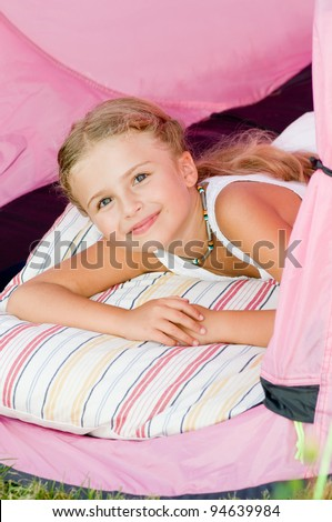 Child camping in tent - lovely girl on camp tent - stock photo