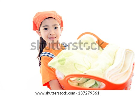 Child carrying laundry basket