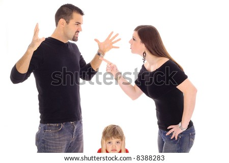 child caught in the middle - stock photo