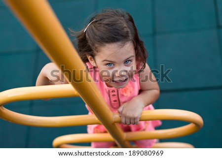 Child climbing up to the chute on the playground - stock photo