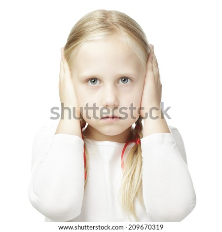 Child closed his hands over his ears and hears nothing - stock photo