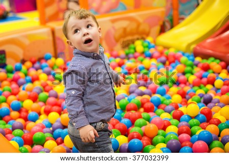 child, colored balls, the game