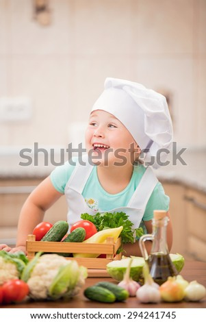 child cook with vegetables in the kitchen - stock photo
