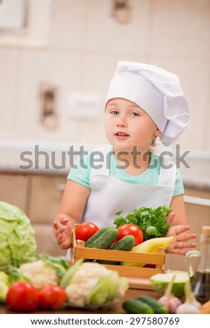 child cook with vegetables in the kitchen