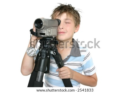 Child creating a short movie using video camera and tripod.  Whtie background - stock photo