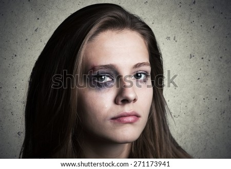 Child. Dark portrait of a crying teen girl, studio shot - stock photo
