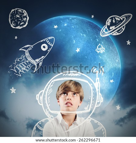 Child daydreams and plays to be astronaut - stock photo