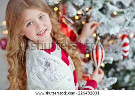 child decorate the Christmas tree - stock photo