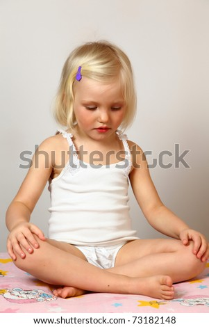 child does exercise and meditation - stock photo