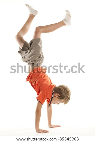Child Doing a Hand Stand - stock photo