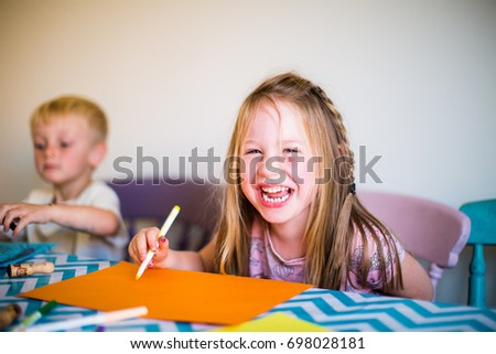 Child doing homework drawing creative art home schooled