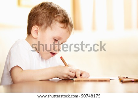 child doing homework or drawing - stock photo