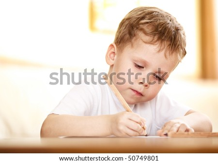 child doing homework or drawing