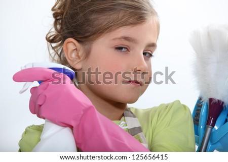 Child doing household chores - stock photo