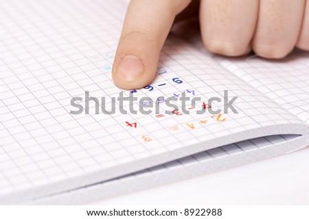 child doing maths homework, adding numbers - stock photo