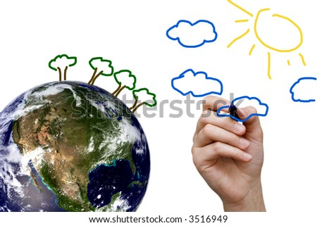 child drawing a better world on top of the earth globe