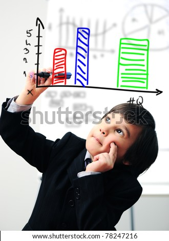Child drawing  a diagram on digital screen - stock photo
