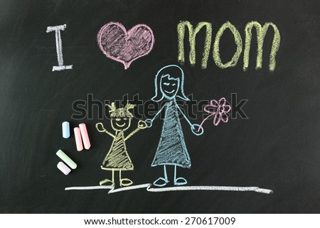 Child drawing of I love mom picture using chalk on blackboard - stock photo
