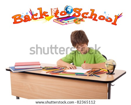 Child drawing on desk with back to school theme on back, isolated on white