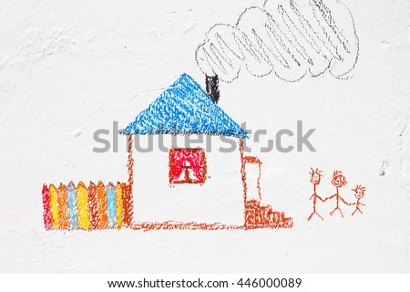 child drawing on the wall - stock photo