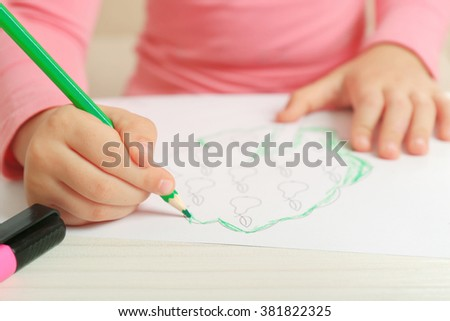 Child drawing tree with pencils on paper, closeup - stock photo
