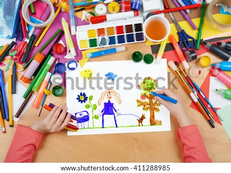 child drawing walking girl with dog, top view hands with pencil painting picture on paper, artwork workplace - stock photo
