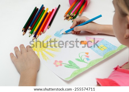Child draws a pencil drawing of the world - stock photo